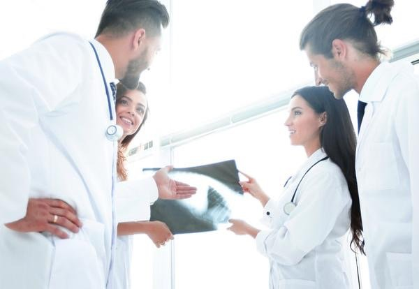 group-of-doctors-and-nurses-looking-at-xray
