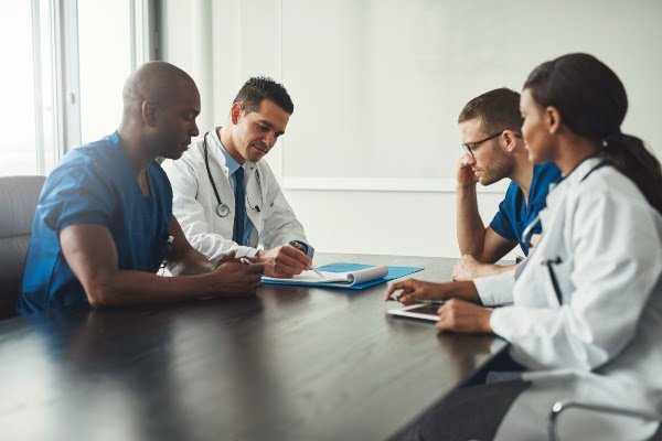 group-of-physicians-reviewing-information