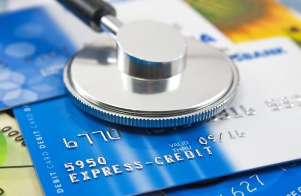 stethoscope-on-top-of-blue-credit-cards